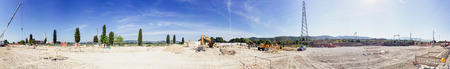 construction machinery: Panoramic view of building site under construction.