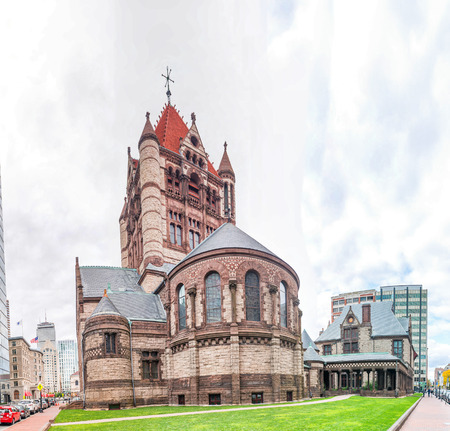 annually: BOSTON - SEPTEMBER 2015: Trinity Church on a cloudy day. Boston attracts 10 million people annually. Editorial