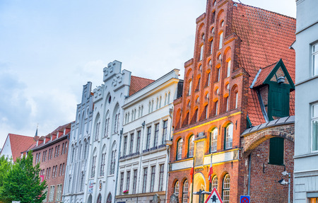 annually: LUBECK, GERMANY - JULY 22, 2016: City medieval buildings. Lubeck attracts over a million visitors annually. Editorial