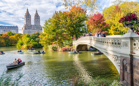 NEW YORK CITY - OCTOBER 2015: Tourists in Central Park enjoy foliage season. The city attracts 50 million people annually.