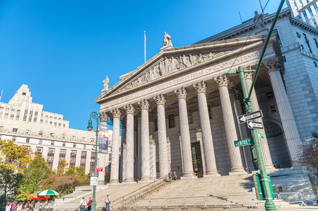 NEW YORK CITY - SEPTEMBER 2015: Tourists visit New York County Courthouse in Manhattan. The city attracts 50 million people annually.