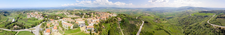 Tuscany countryside and medieval town on the hill. Amazing panoramic aerial view.