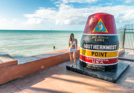 KEY WEST, FL - FEBRUARY 21, 2016: Southernmost point post along the ocean. This is a famous attraction in Key West.