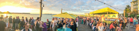 KEY WEST, FL - FEBRUARY 2016: Tourists awaits sunset in Mallory Square, panoramic view. Key West is a major tourist destination in Florida.