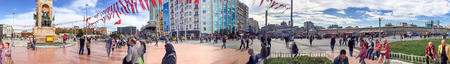 ISTANBUL - OCTOBER 2014: Tourists in Taksim Square. Istanbul attracts 10 million people annually.
