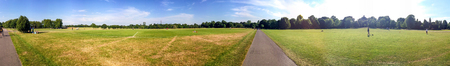 Tourists walk in Hyde Park, panoramic view, London.