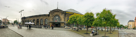 DRESDEN, GERMANY - JULY 2016: Panoramic view of city railway station area. Dresden attracts 5 million people annually.