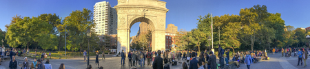 NEW YORK CITY - OCTOBER 2015: Tourists walk in Washington park. New York attracts 50 million people annually.