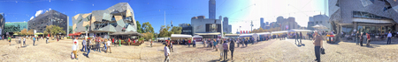 MELBOURNE - NOVEMBER 2015: Panoramic view of Federation Square. Melbourne attracts 10 million tourists annually.