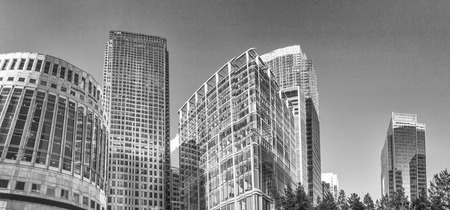 annually: LONDON - SEPTEMBER 2016: Buildings of Canary Wharf, panoramic view. London attracts 30 million people annually.