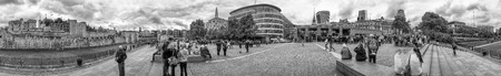 million: LONDON - SEPTEMBER 2016: Tourists walk near Tower Of London, panoramic view. London attracts 30 million people annually.