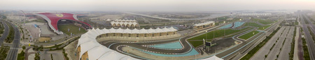 ABU DHABI - DECEMBER 2016: Ferrari World and F1 circuit, aerial view. Abu Dhabi attract 10 millnion tourists annually.