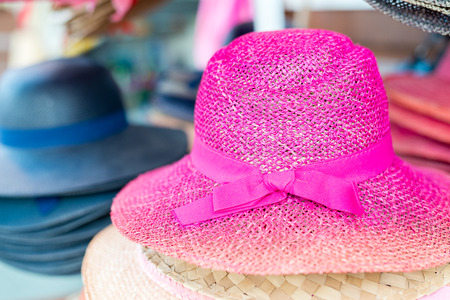 seller: Colourful hats in the market. Stock Photo