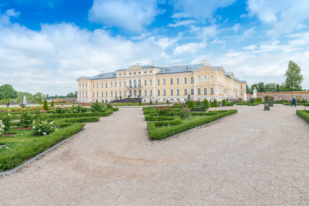 rundale: RUNDALE, LATVIA - JULY 12, 2017: Tourists visit Rundale Palace. This is a famous attraction in Latvia.