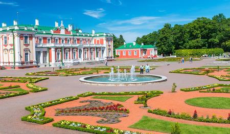 TALLINN, ESTONIA - JULY 15, 2017: Tourists visit Kadriorg Palace. Tallinn attracts 2 million people annually.