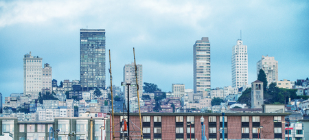 Buildings of Downtown San Francisco from Fishermans Wharf. San Francisco welcomes 25 million visitors every year.