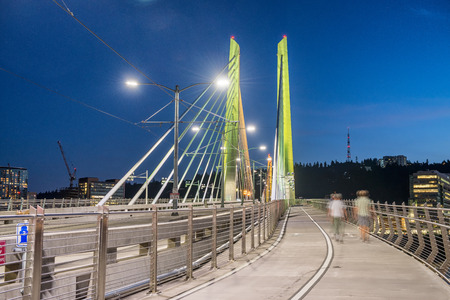 Tilikum Crossing in Portland, OR. Night view with people moving.
