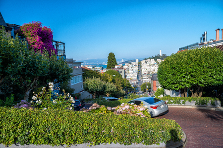 SAN FRANCISCO - AUGUST 7TH, 2017 - Tourists in Lombar Street. It is claimed as the most crooked street in the world, located along the eastern segment in the Russian Hill neighborhood.