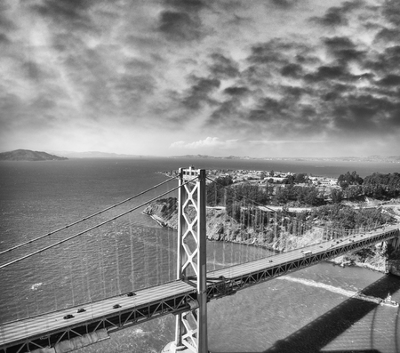 Aerial view of Bay Bridge in San Francisco from helicopter, CA.