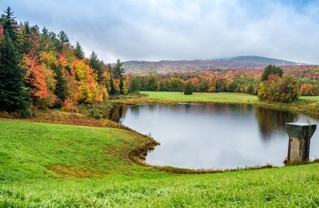 Beautiful lake reflection in New England during foliage season.