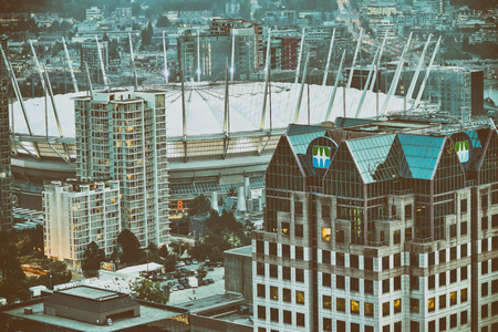 Aerial view of Vancouver skyscrapers and stadium, Canada.
