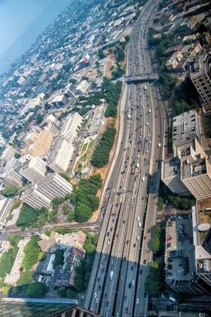 Aerial view of interstate crossing metropolis.