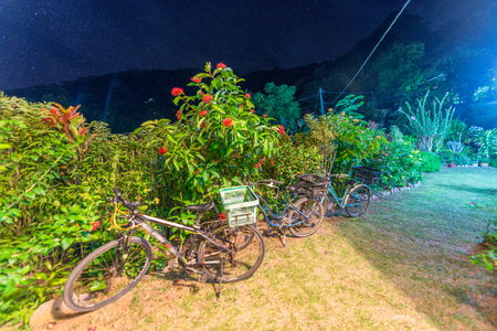 Parked bikes at night in La Digue - Seychelels. Stock Photo