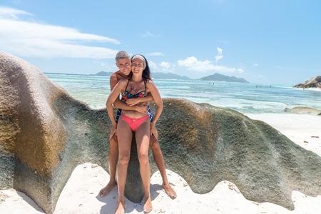 la digue: Beautiful couple in 40s relaxing along La Digue rocks, Seychelles.