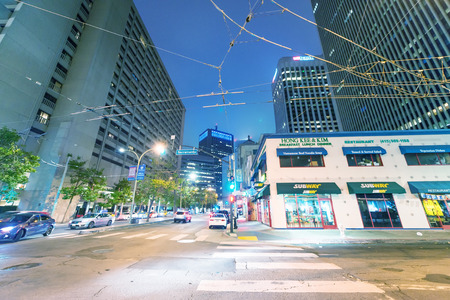 SAN FRANCISCO - AUGUST 5, 2017: City streets in Downtown at night. San Francisco attracts 20 million people annually.