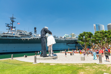 SAN DIEGO - JULY 30, 2017: Unconditional Surrender sculpture at sea port. By Seward Johnson, the statue resembles the photograph of V-J day in Times Square.