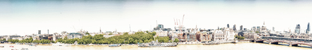 LONDON - MAY 2013: Beautiful panoramic view of city buildings along river Thames. London attracts 30 million tourists annually. Editorial