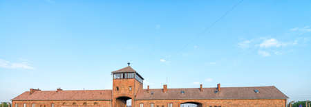 Watch Tower and main entrance at concentration camp Auschwitz Birkenau Poland.