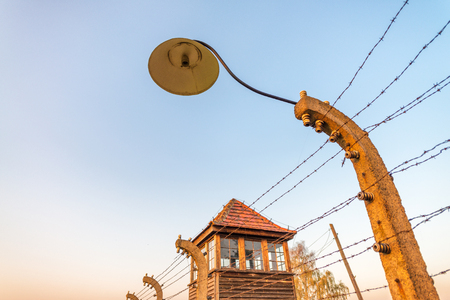 barbed wire fence: Barbed wire and Watch Tower in a concentration camp in Auschwitz (Poland).