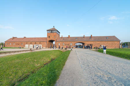 AUSCHWITZ, POLAND - OCTOBER 1ST, 2017: Watch Tower and main entrance at concentration camp Auschwitz Birkenau Poland.