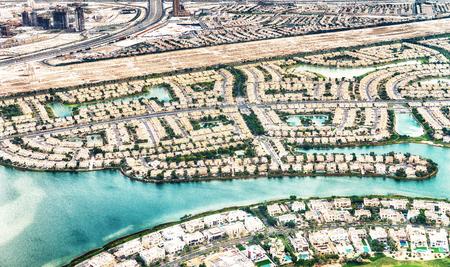 Dubai aerial view of homes near artificial canals.