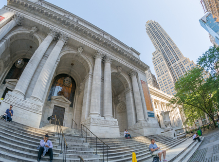 NEW YORK CITY - JUNE 2013: People walk along Public Library. This is a main attraction for tourists. Editorial