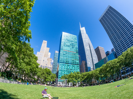 NEW YORK CITY - JUNE 14, 2013: Fisheye view of Bryant Park in summer. New York attracts 50 million tourists every year.