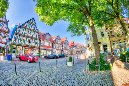 CELLE, GERMANY - JULY 18, 2016: Tourists in Brandplatz. Celle attracts 3 million people annually.