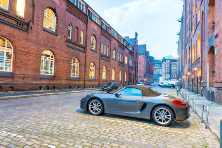 HAMBURG - JULY 21, 2016: Sport car parked along city streets. Hamburg attracts 10 million tourists annually. Editorial