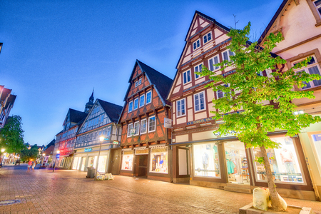 CELLE, GERMANY - JULY 18, 2016: Tourists in Schuhstrasse. Celle attracts 3 million people annually.