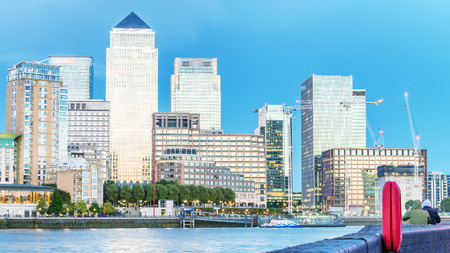 Canary Wharf night skyline with Thames river reflections, London - UK. Stock Photo