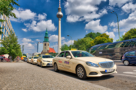 BERLIN, GERMANY - JULY 24, 2016: Taxis along city streets. Berlin attracts 15 million tourists annually. Éditoriale
