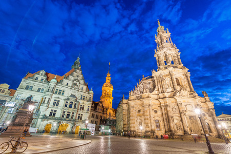 DRESDEN, GERMANY - JULY 15, 2016: Tourists along old city streets at night. Dresden attracts 5 million tourists annually.