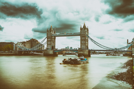 Tower Bridge and Thames River, blurred view with long exposure.