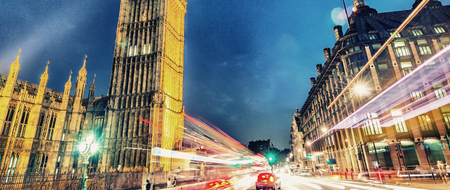 Westminster Bridge at night with cars speeding up - London.