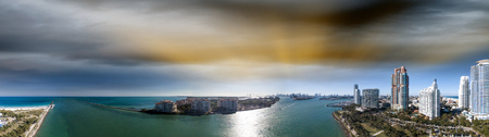 Miami Beach in South Pointe Park. Panoramic aerial view at dusk.