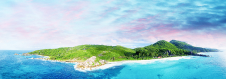 Panoramic aerial view of beautiful tropical Island at sunset.
