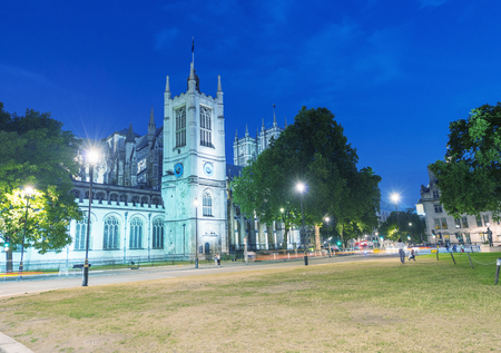 LONDON - JUNE 2015: Westminster Abbey Precincts Park. London attracts 30 million tourists annually.
