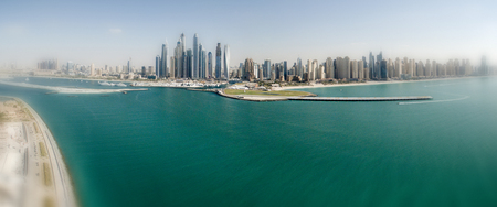 Dubai Marina skyline aerial view at sunset from Palm Jumeirah Island.