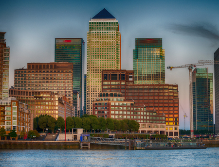 Canary Wharf skyscrapers at sunset, the financial district of the city.